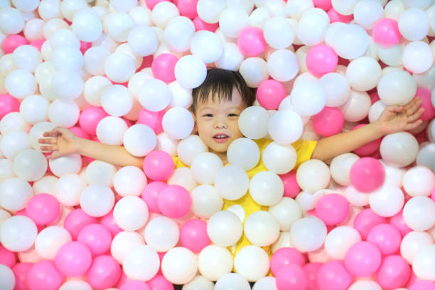 Above view portrait of cute little asian kid in ball pit full of picture id1200870991?b=1&k=6&m=1200870991&s=612x612&w=0&h=hrexfyedv gtdr7h7fe chjtxcghtceeyvapymqu54q=