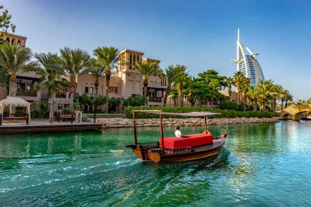 abra boat ride in souk medinat jumeirah Dubai,UAE 11. 03. 2018 : abra boat ride in souk medinat jumeirah with the burj al arab dubai stock pictures, royalty-free photos & images