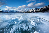 Abraham Lake, Alberta, this reservoir is the largest man made lake in Alberta. Situated on the Kootenay Plains. Created by daming the North Saskatchewan river. Frozen ice bubbles rise from the plant life at the bottom of the lake. Its methane gas.