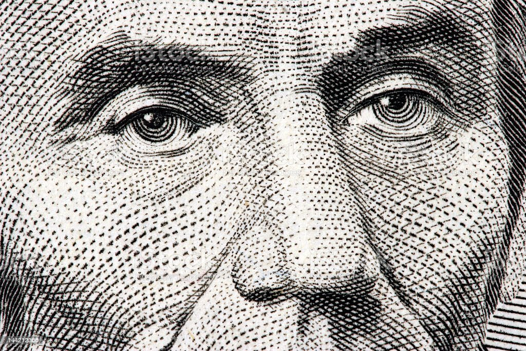 Abraham Lincoln close up from 5 dollar bill stock photo