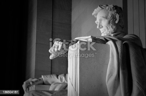 A monochrome image of the statue of Abraham Lincoln in the Lincoln in the Lincoln Memorial in Wahsington, DC.