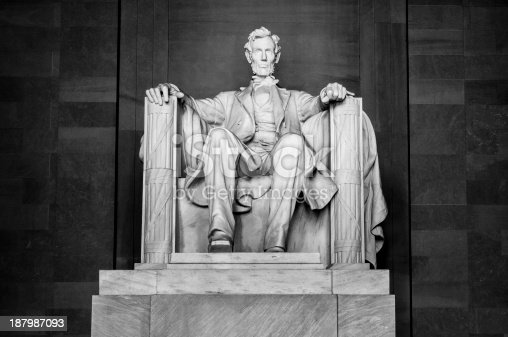 A monochrome image of the statue in the Abraham Lincoln Memorial in Washington, DC.