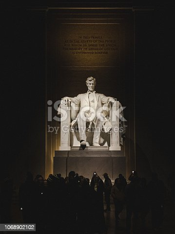 The 16th US president is depicted as a seated marble statue, which was carved by the Piccirilli Brothers and took four years to complete. Shot on iPhone XS Max. Directly behind the Lincoln statue you can read these words carved into the wall: