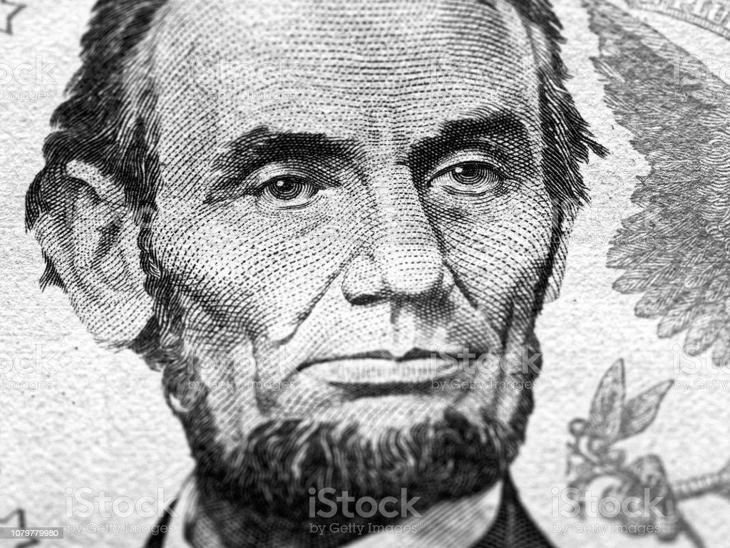 Abraham Lincoln portrait macro on 5 dollars money usa american banknote stock photo
