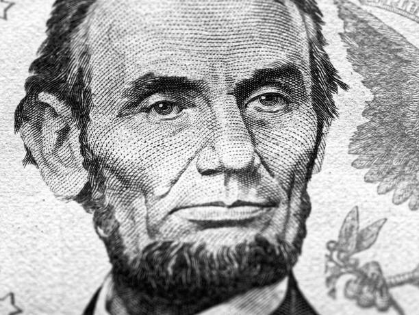 Abraham Lincoln portrait macro on 5 dollars money usa american banknote stock photo