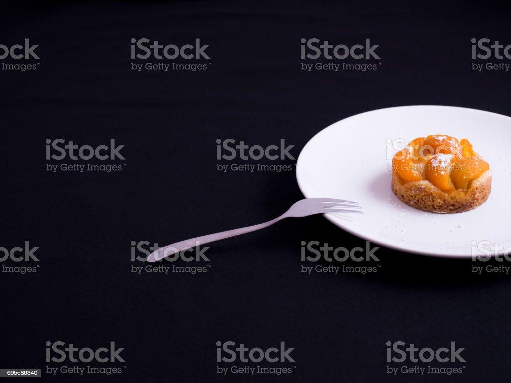 Abricot tart isolated on black stock photo