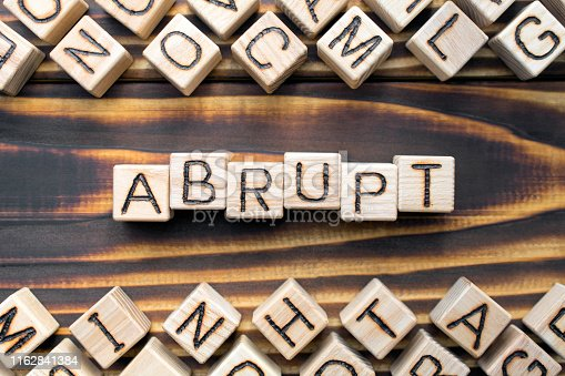 istock abrupt wooden cubes with letters 1162841384