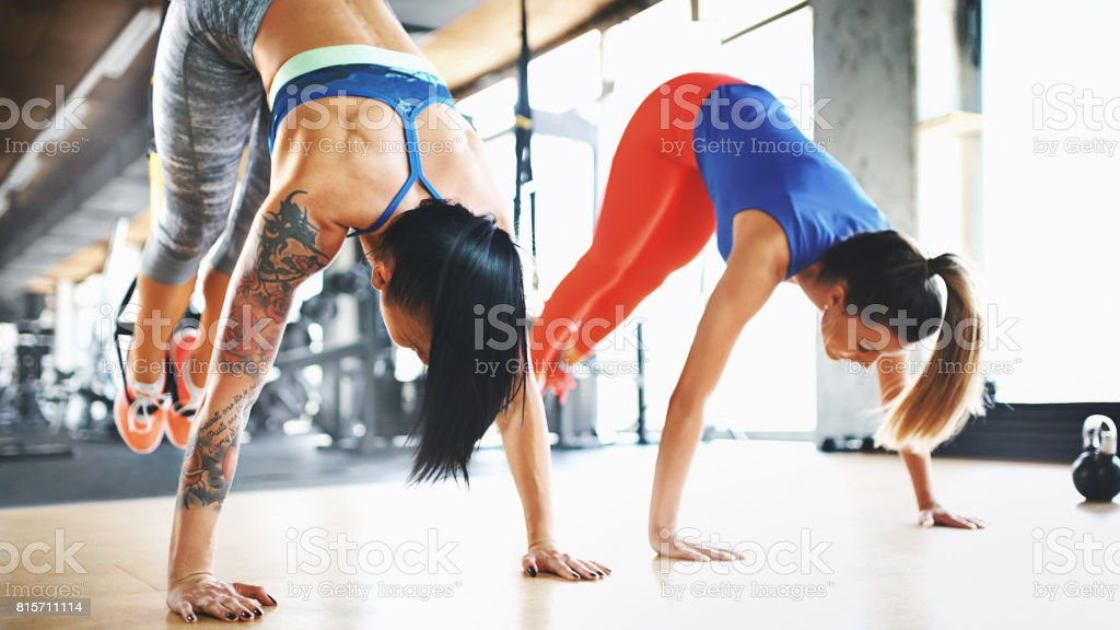 Abs and core workout with suspension cables. stock photo