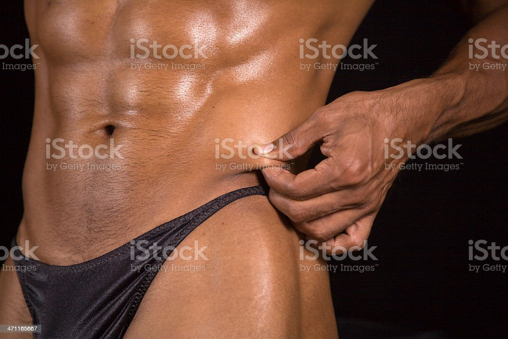 abs and trim torso with skin fold fat test royalty-free stock photo