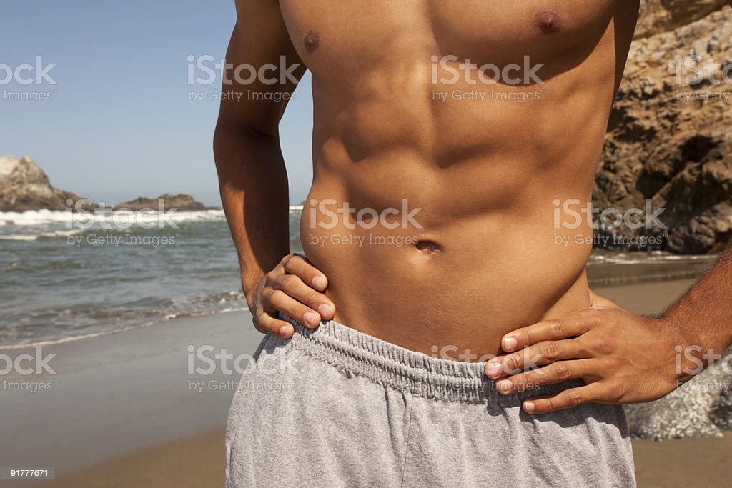 Abs on the beach royalty-free stock photo