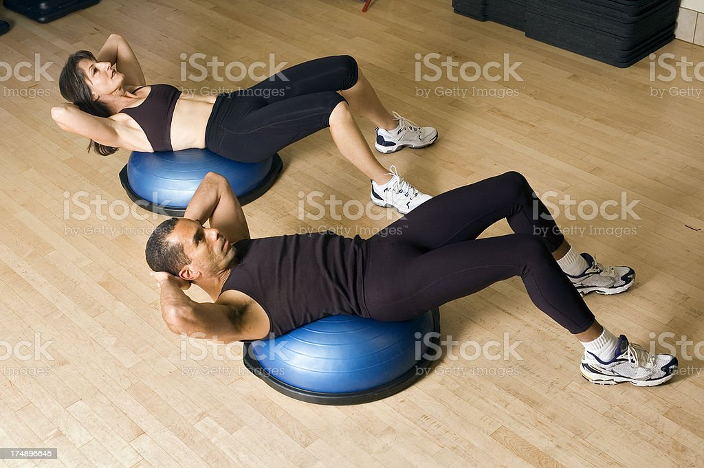 Abs Workout on Bosu Balance Trainer Balls stock photo
