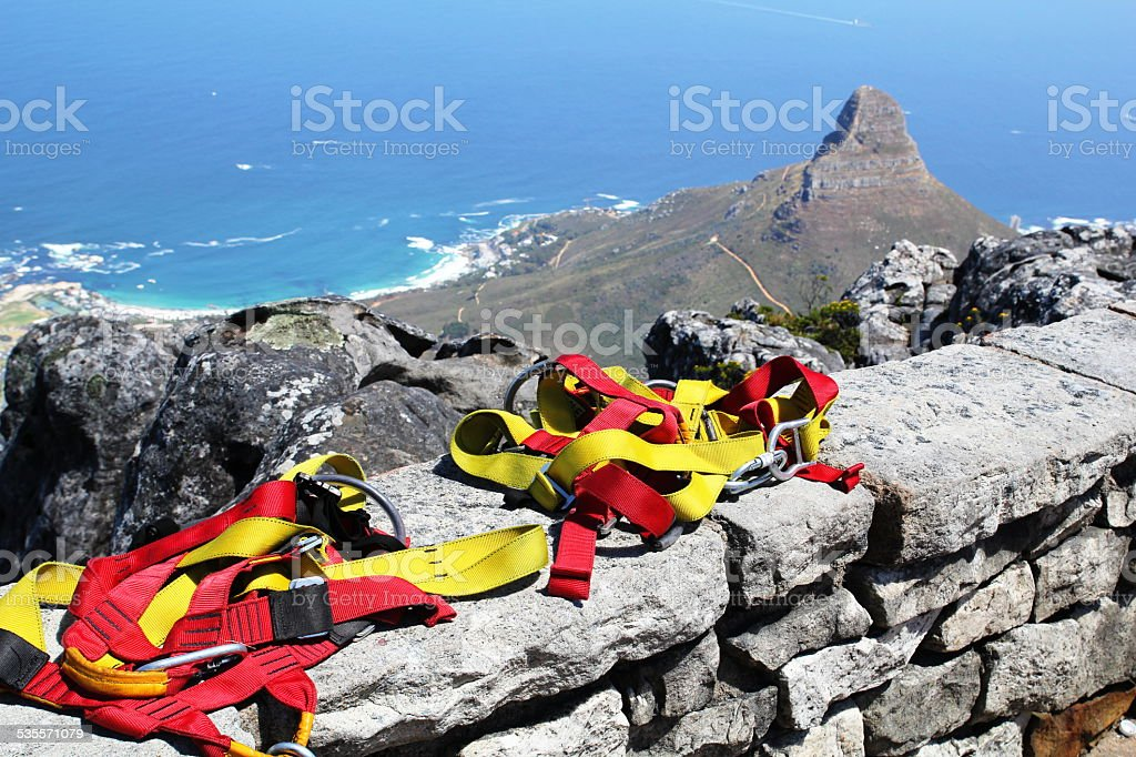 Abseiling off Table Mountain in the city of Cape Town stock photo