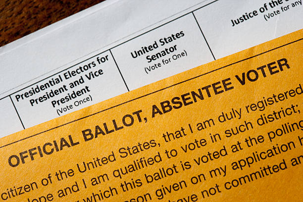 US absentee official voting ballot New York, United States - October 25, 2016: US Presidential absentee ballot photographed on a table with Government supplied envelope as a conceptual editorial still life absentee stock pictures, royalty-free photos & images