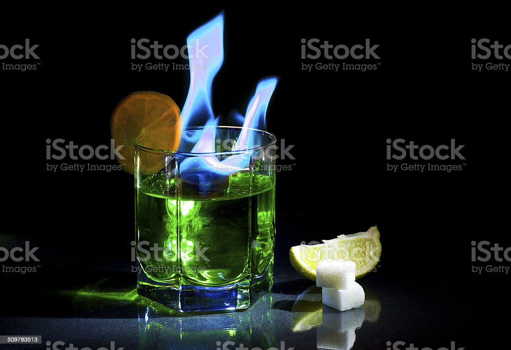 Absinthe burning on a black background stock photo