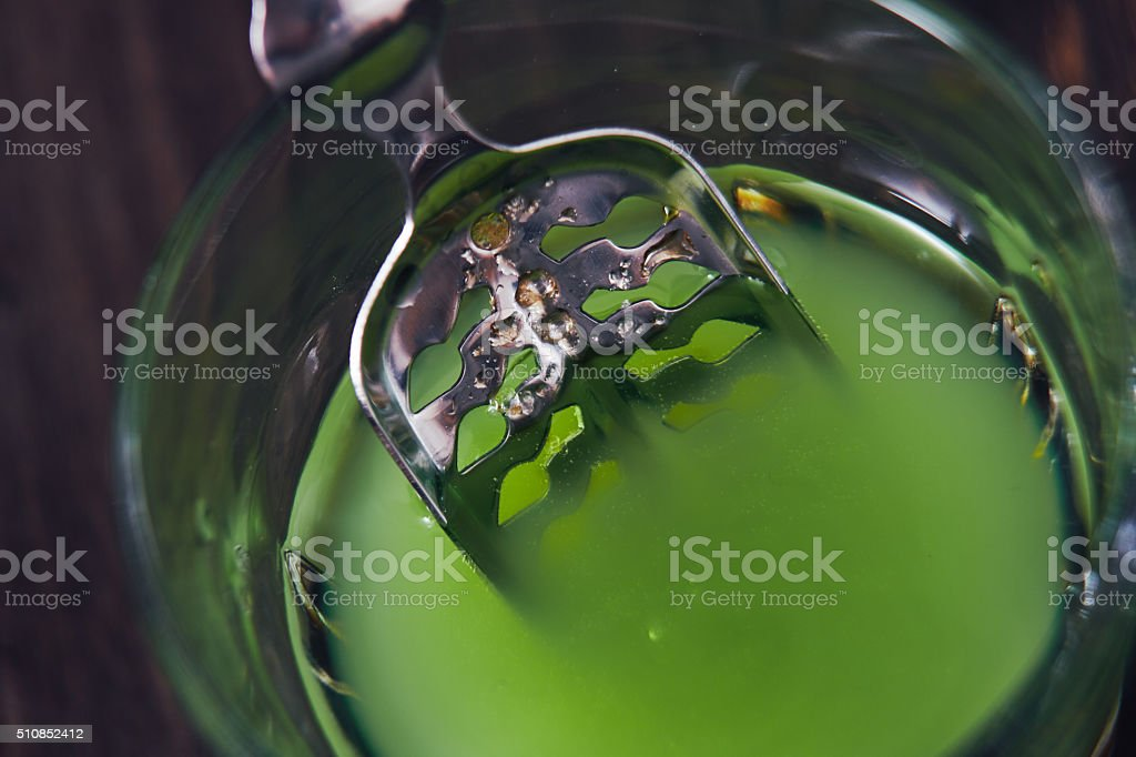 Absinthe In Glass With Spoon stock photo