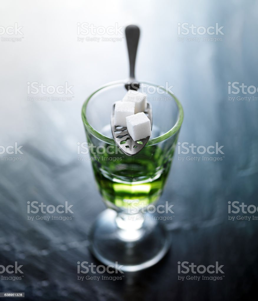 absinthe in pontarlier glass stock photo