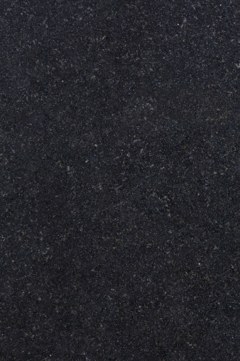a high definition view of Absolute Black  Granite (also known as Absolutto Black or Indian Black Granite) with its fine dense jet-black and silvery grains creating a very dark finish that is known to be very hard and durable. Originating from Southern India, this type of granite is used extensively for decorative purposes in kitchens, bathrooms, work tops, monuments, facades and also flooring.
