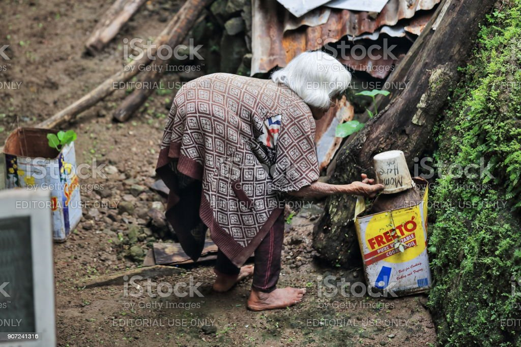 Absolutely hunched old woman of the Ifugao people. Batad-Banaue-Luzon-Philippines. 0129 stock photo