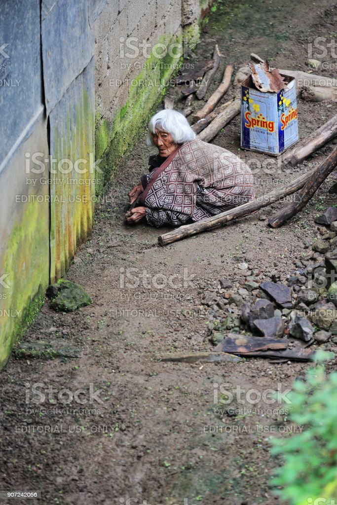 Absolutely hunched old woman of the Ifugao people. Batad-Banaue-Luzon-Philippines. 0130 stock photo