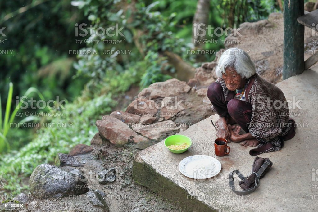 Absolutely hunched old woman of the Ifugao people. Batad-Banaue-Luzon-Philippines. 0172 stock photo
