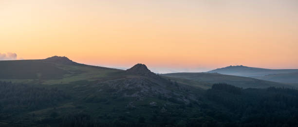 Absolutely stunning landscape image of Dartmoor in England showing Leather Tor, Sharpitor and Kings Tor in majestic sunrise light stock photo