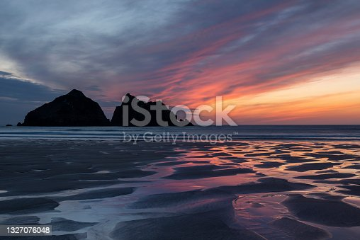 istock Absolutely stunning landscape images of Holywell Bay beach in Cornwall UK during golden hojur sunset in Spring 1327076048