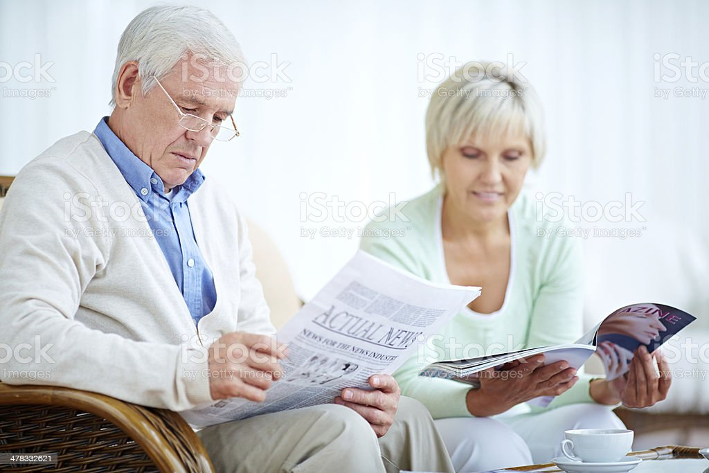 Absorbed in reading royalty-free stock photo