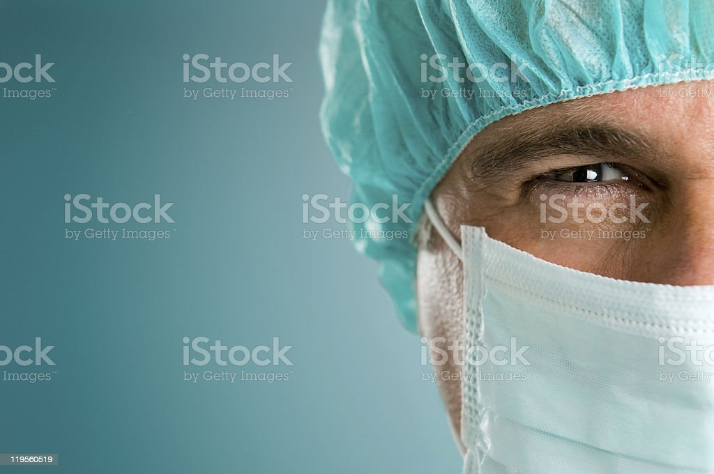 Absorbed surgeon closeup stock photo
