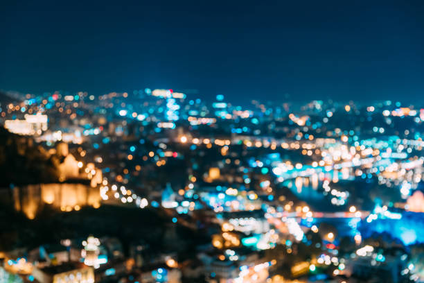 Absract Blurred Bokeh Architectural Urban Backdrop Of Tbilisi, Georgia. Real Blurred Colorful Bokeh Background With Defocused Glowing Lights stock photo