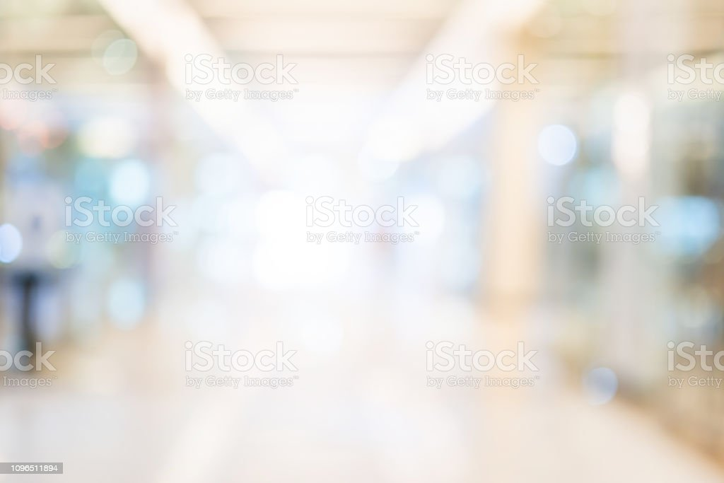 abstact blur image background of shopping mall with crowd people stock photo