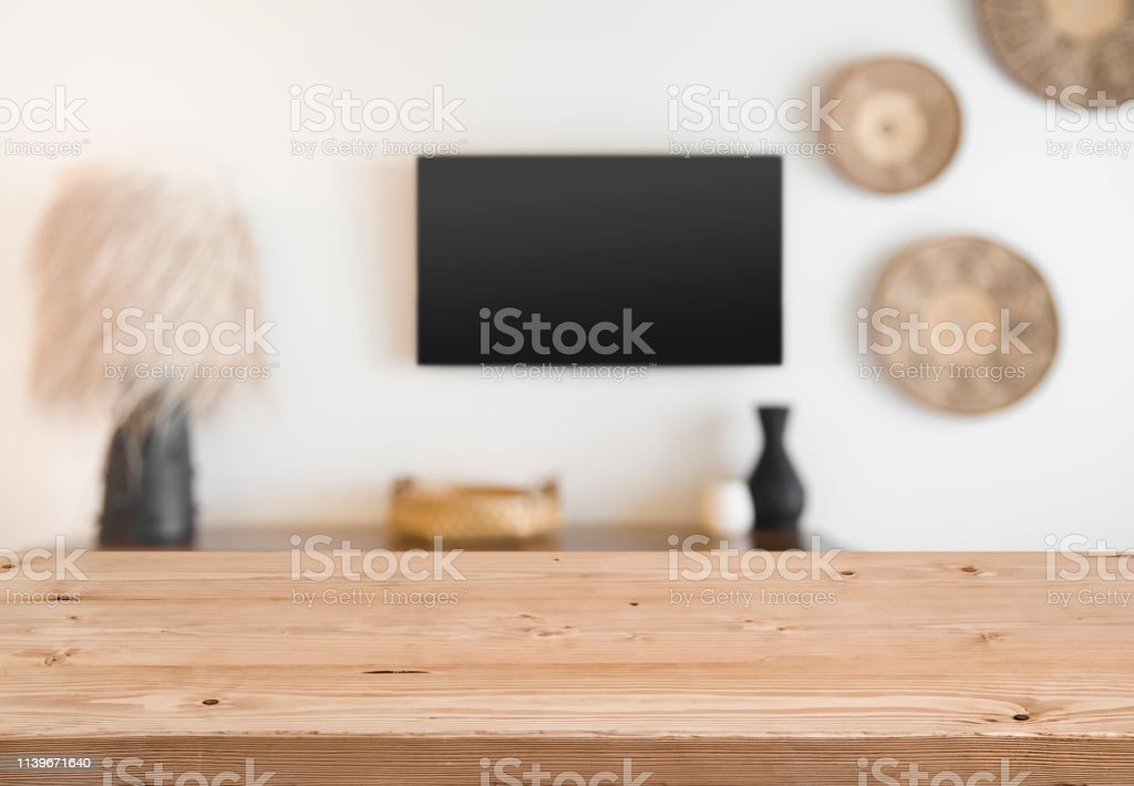 Abstact defocused tropical hotel wall with wooden table in front stock photo