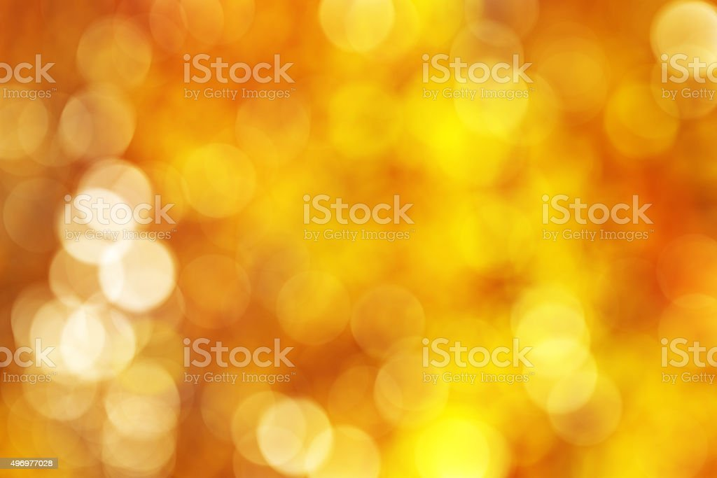 Abstact golden, yellow, orange circle bokeh background stock photo