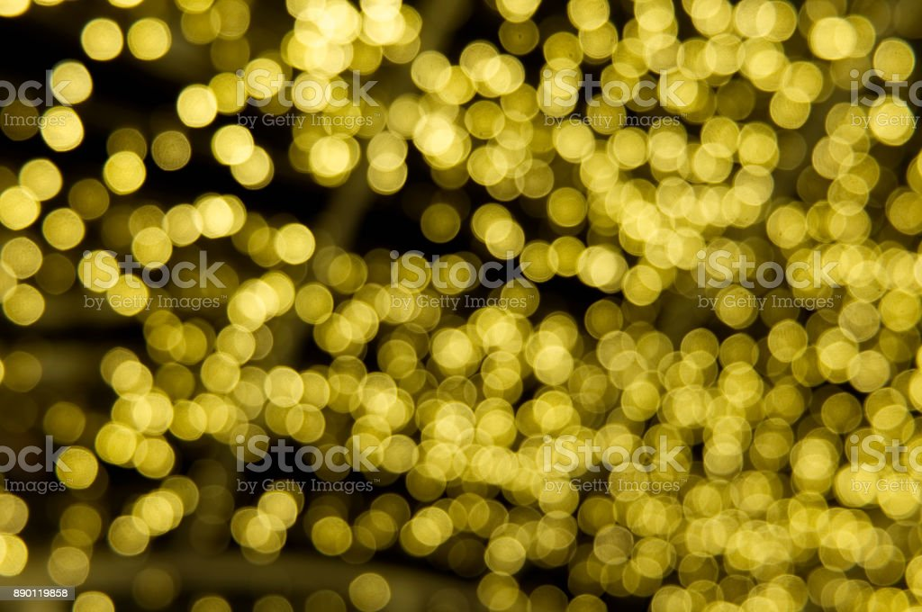 Abstact Shiny Yellow Bokeh in Dark Background stock photo