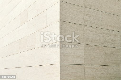 Close up of a facade made of block stones.