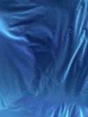 Abstract 3d rendering silver cloth background illuminated blue light