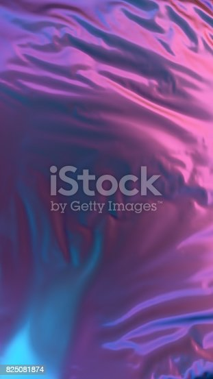 istock Abstract 3d rendering silver cloth illuminated multicolored light 825081874