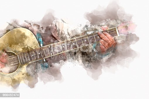 istock Abstract a man playing acoustic guitar watercolor colorful painting background. 956452474