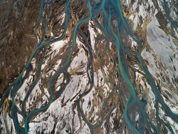 Abstract aerial of braided river in highlands of Iceland. Abstract aerial picture of  braided river in the highlands of south Iceland. Beautiful abstract pattern of river with multi colour effect in Fjallabak, Landmannalaugar Iceland. True art of nature. riverbed stock pictures, royalty-free photos & images