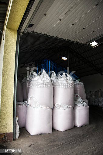 istock Abstract agrarian image with bags of grain in the agricultural sector in the farm. (good harvest, abundance - concept) 1137754155