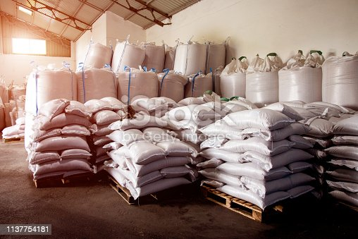 istock Abstract agrarian image with bags of grain in the agricultural sector in the farm. (good harvest, abundance - concept) 1137754181