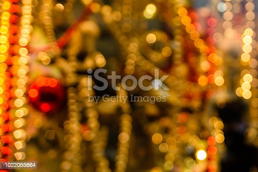 857847778 istock photo Abstract and blurred background of christmas decorations 1022055864