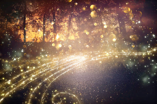 Abstract and magical image of glitter Firefly flying in the night forest. Fairy tale concept. stock photo