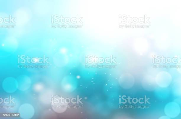 Photo of Abstract aqua blue blurred bokeh background.