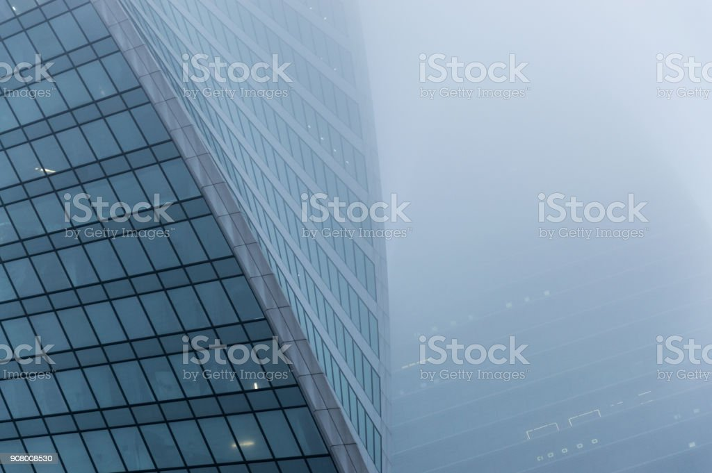 Abstract architecture forms of the modern skyscrapers walls made with metal and glass stock photo