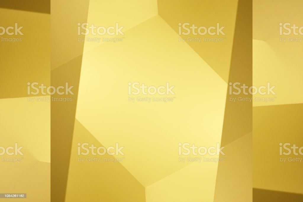Abstract architecture sketch of walls and ceiling. Polyhedron composition. Geometric background with polygonal structure of yellow corners / angular shapes. Graphic pattern with copy space for text. stock photo