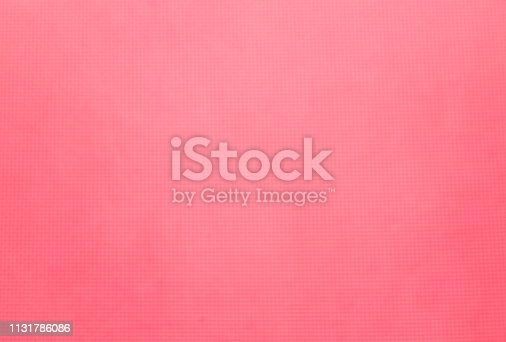 Abstract artistic blurred magenta or pink background wallpaper with squares of yoga mat or pad close up
