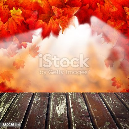 Abstract Autumn Background with Empty Wooden Table, Golden Bokeh and Fall Leaves for a Catering or Food Board. Template for Display of Product