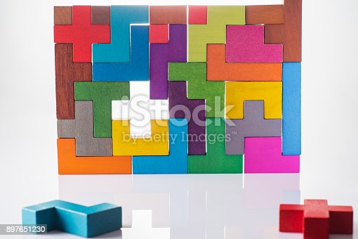 istock Abstract Background. Background with different colorful shapes wooden blocks. Geometric shapes in different colors. Concept of creative, logical thinking or problem solving. Decision making process. 897651230