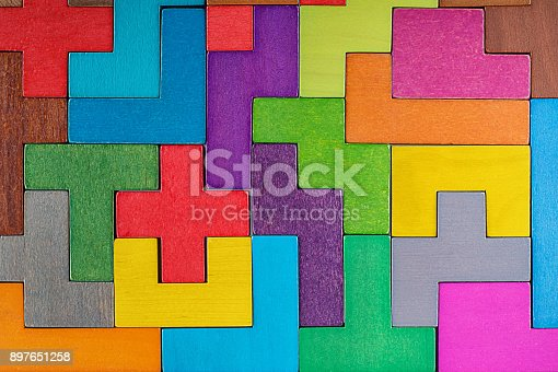 istock Abstract Background. Background with different colorful shapes wooden blocks . Geometric shapes in different colors. Concept of creative, logical thinking or problem solving. 897651258