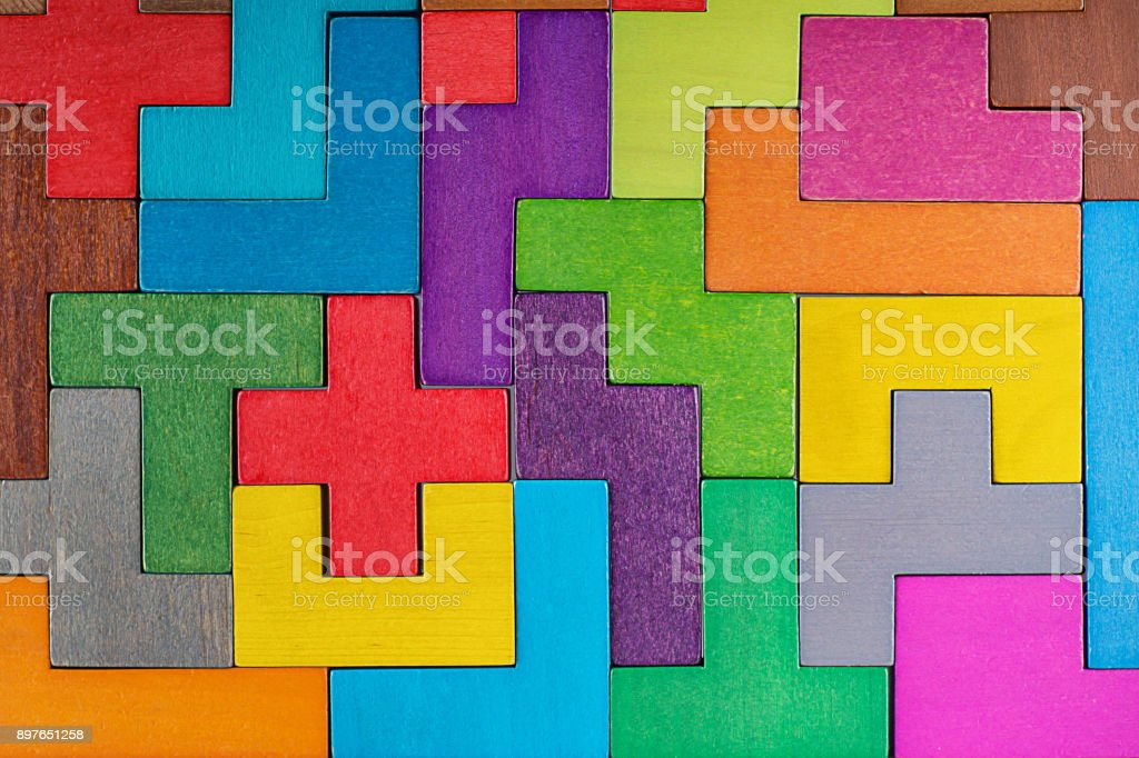 Abstract Background. Background with different colorful shapes wooden blocks . Geometric shapes in different colors. Concept of creative, logical thinking or problem solving. stock photo